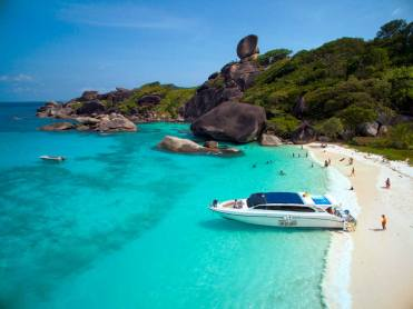 Similan Island beach with speedboat