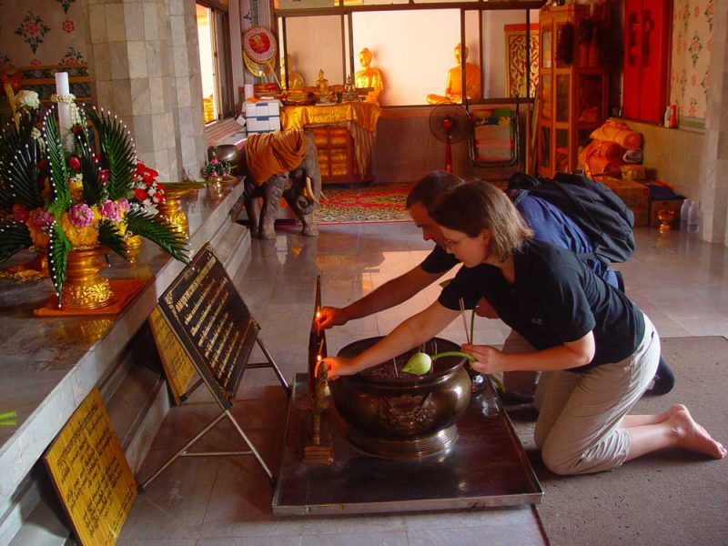 two people kneel in front of an altar Khaolak land discovery
